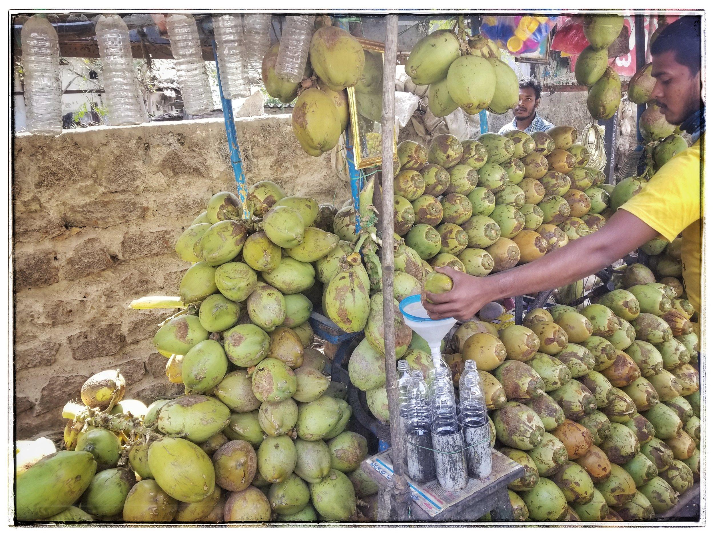 Street vendor making coconut water.