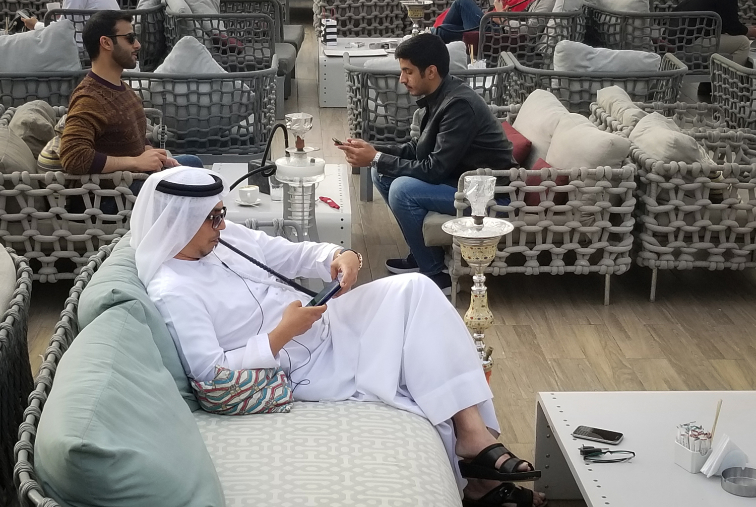 Arab man smoking a hookah.