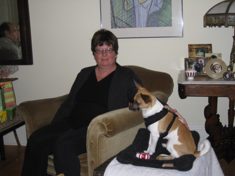 Sherri's with her (and our) dog, Ricci at home.