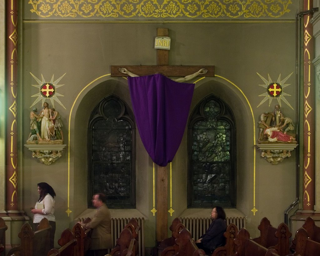 Crucifix covered during Passiontide.