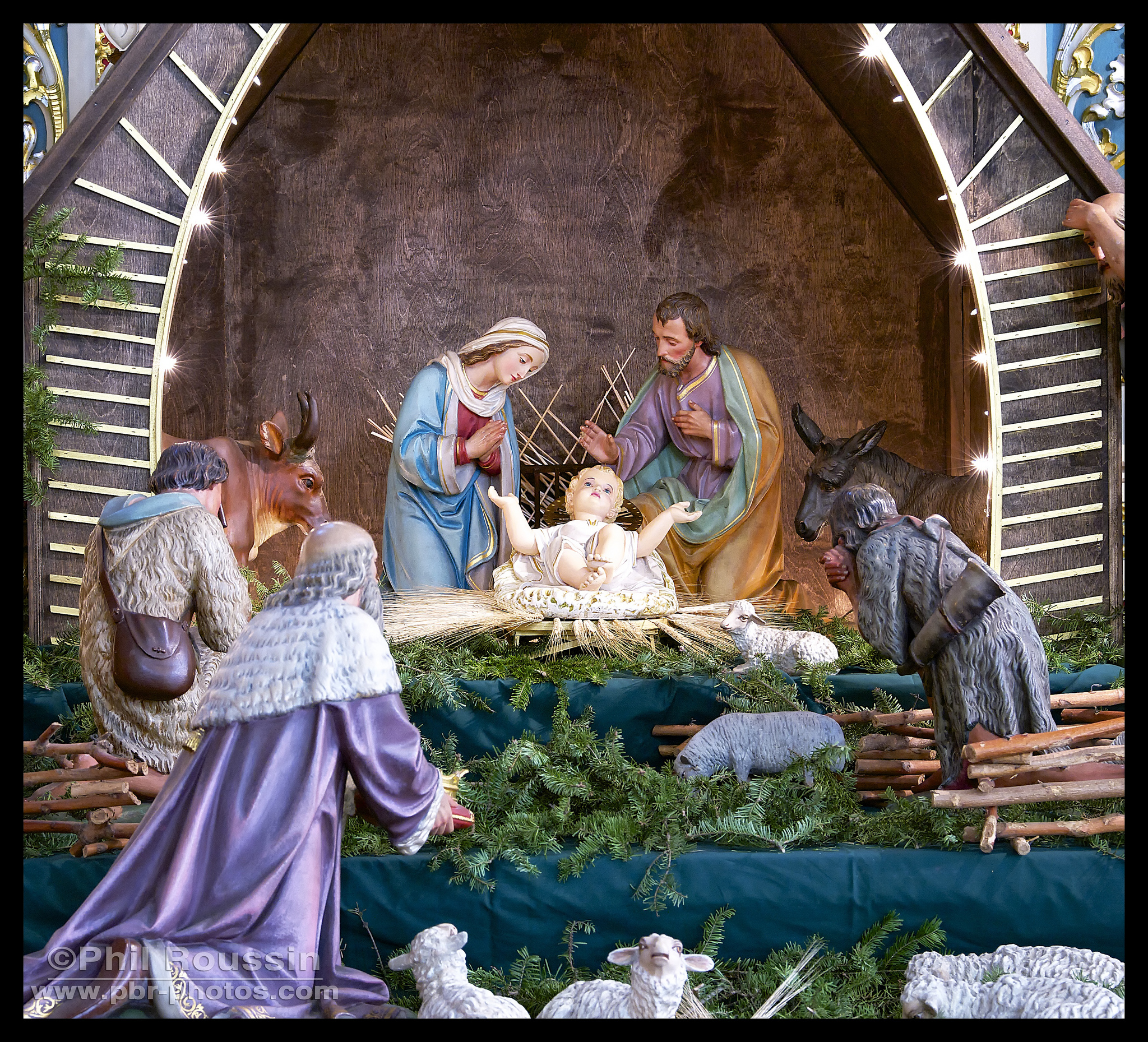 The Nativity scene is placed at the altar of the Blessed Mother during the Christmas season.