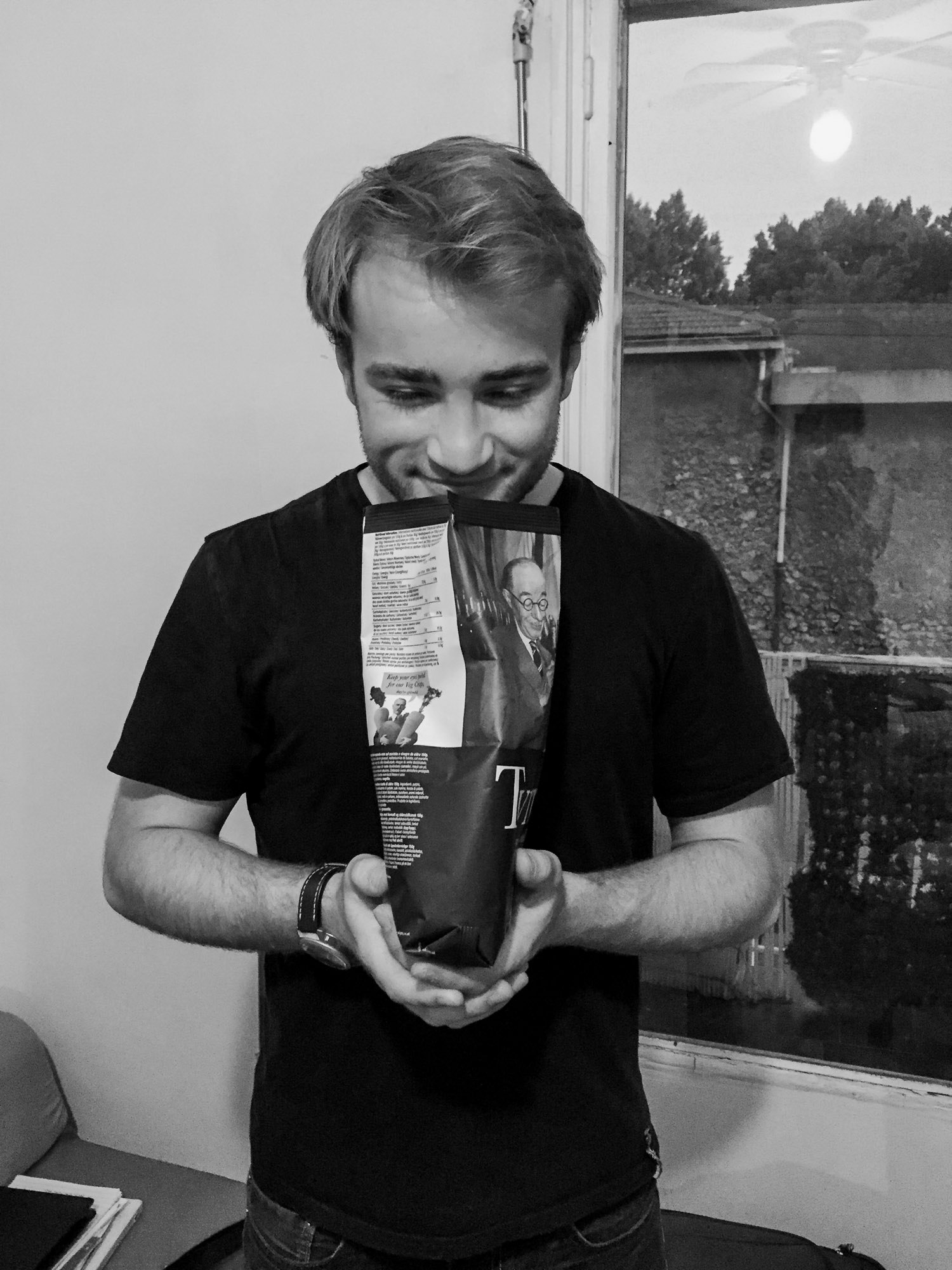 Matt proving his occasional English accent has merit by eating some DELICIOUS English chips. You'd think that chips can't do that much; they're just chips. But look at Matt's face. World-changing chips right there in our Airbnb.