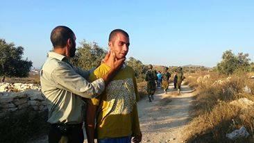 Zoon van man nadat kolonisten hem mishandelden met de hulp van Israëlische soldaten.