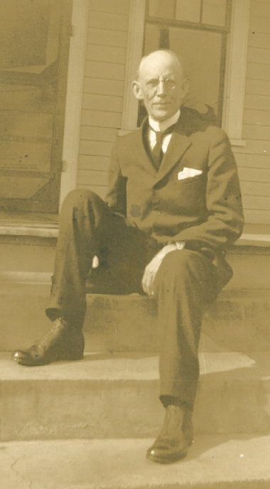 Dr. Campbell seated.jpg.png
