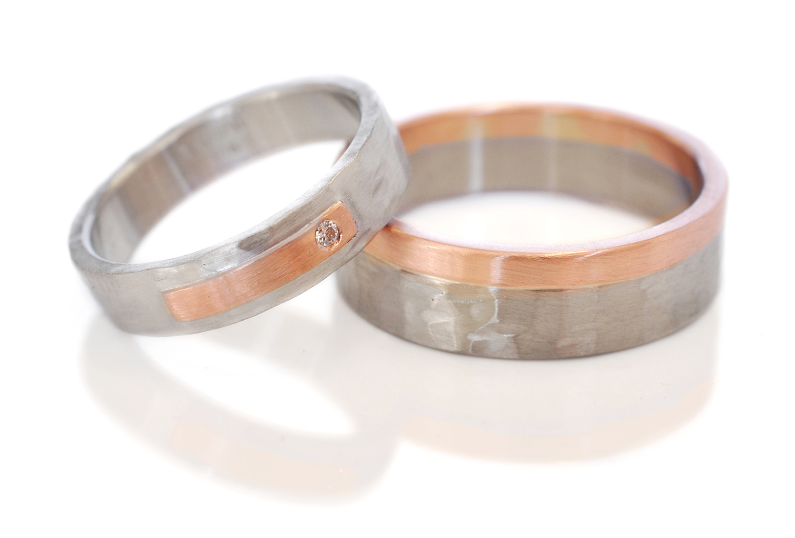 Nick and Katie chose coordinating mixed metal wedding bands with out being too matchy. Palladium and 14k red gold with the random hammered finish.
