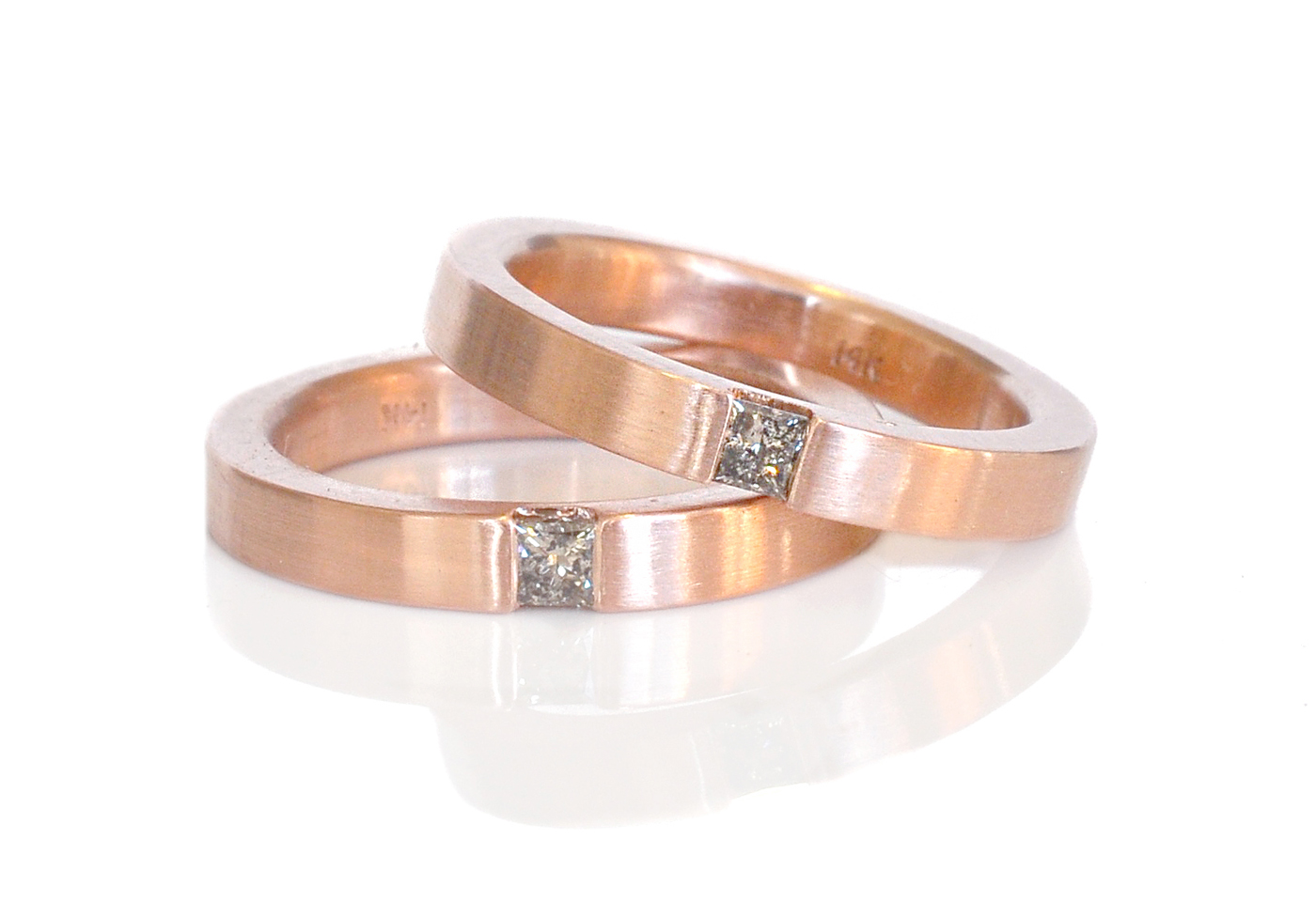 A classic modern wedding in satin finish 14k red gold with salt and pepper princess cut diamonds for an unexpected touch of darkness.