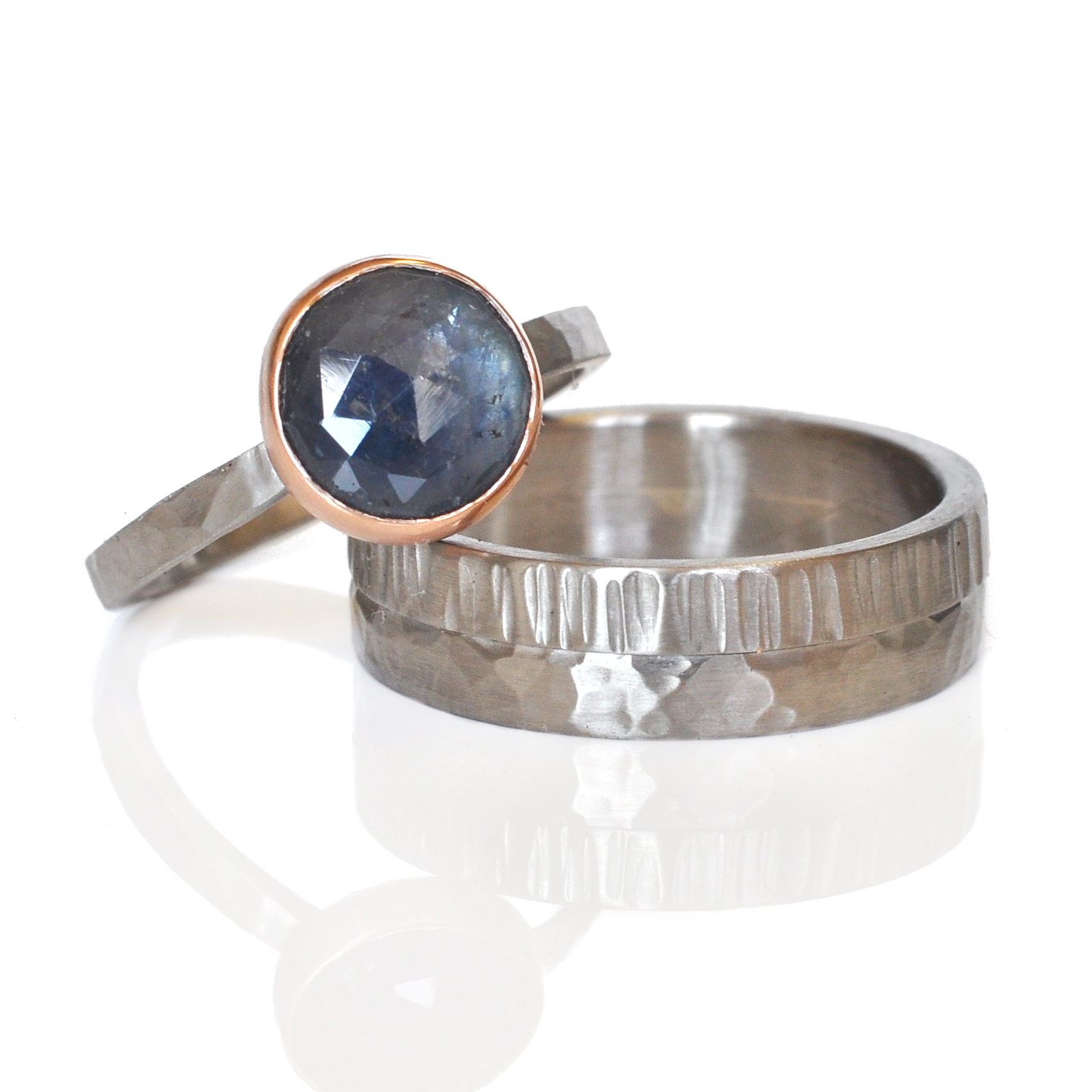 Caitlin picked out one of my favorite rose cut sapphire rings.  The depths of blue in this stone is quite incredible, like gazing into a lake.  Rose cut blue sapphire set in 14k red gold on a hammered palladium band.  Ryan choose a fun mix of textures for his palladium wedding band.
