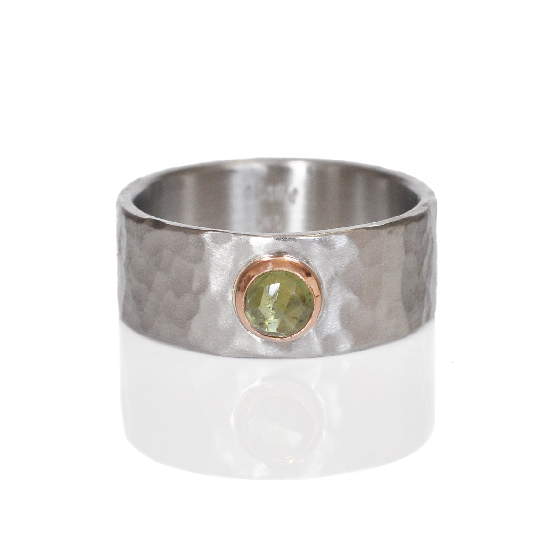Green rose cut sapphire in 14k red gold set into a hammered 950 palladium band.