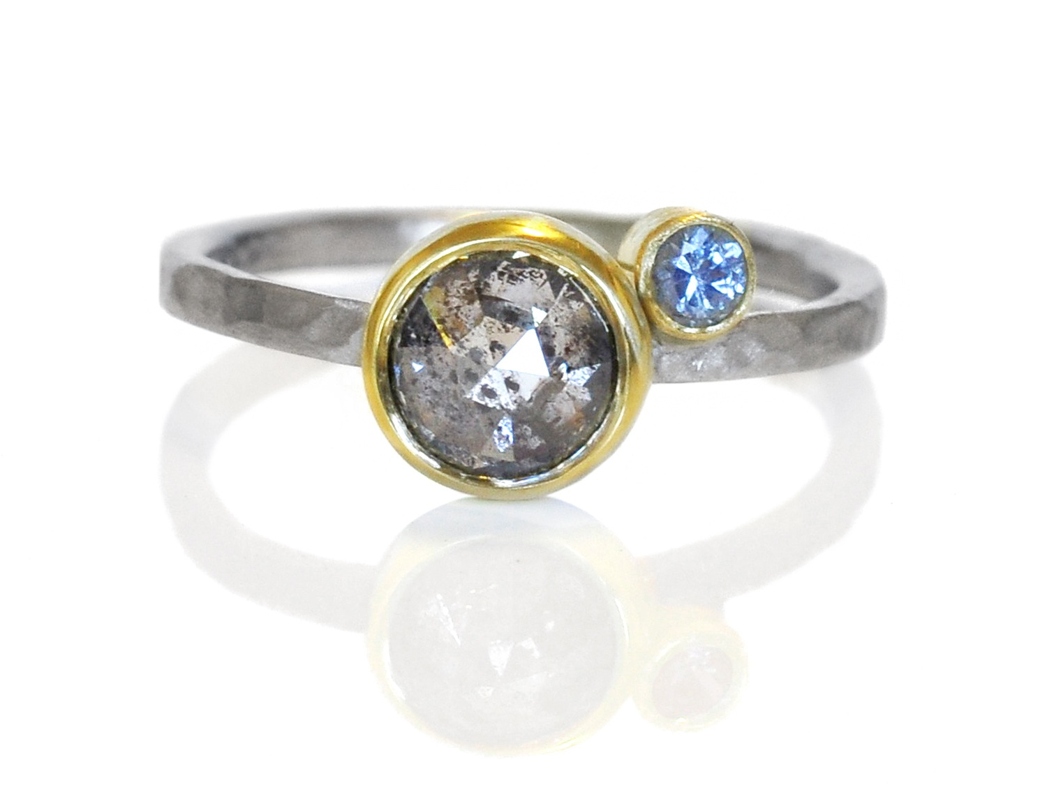 Congratulations Ari and Zuzanna! I love the little bright blue sapphire buddy as compliment to the amazing universe of sparkling inclusions inside this salt and pepper diamond.