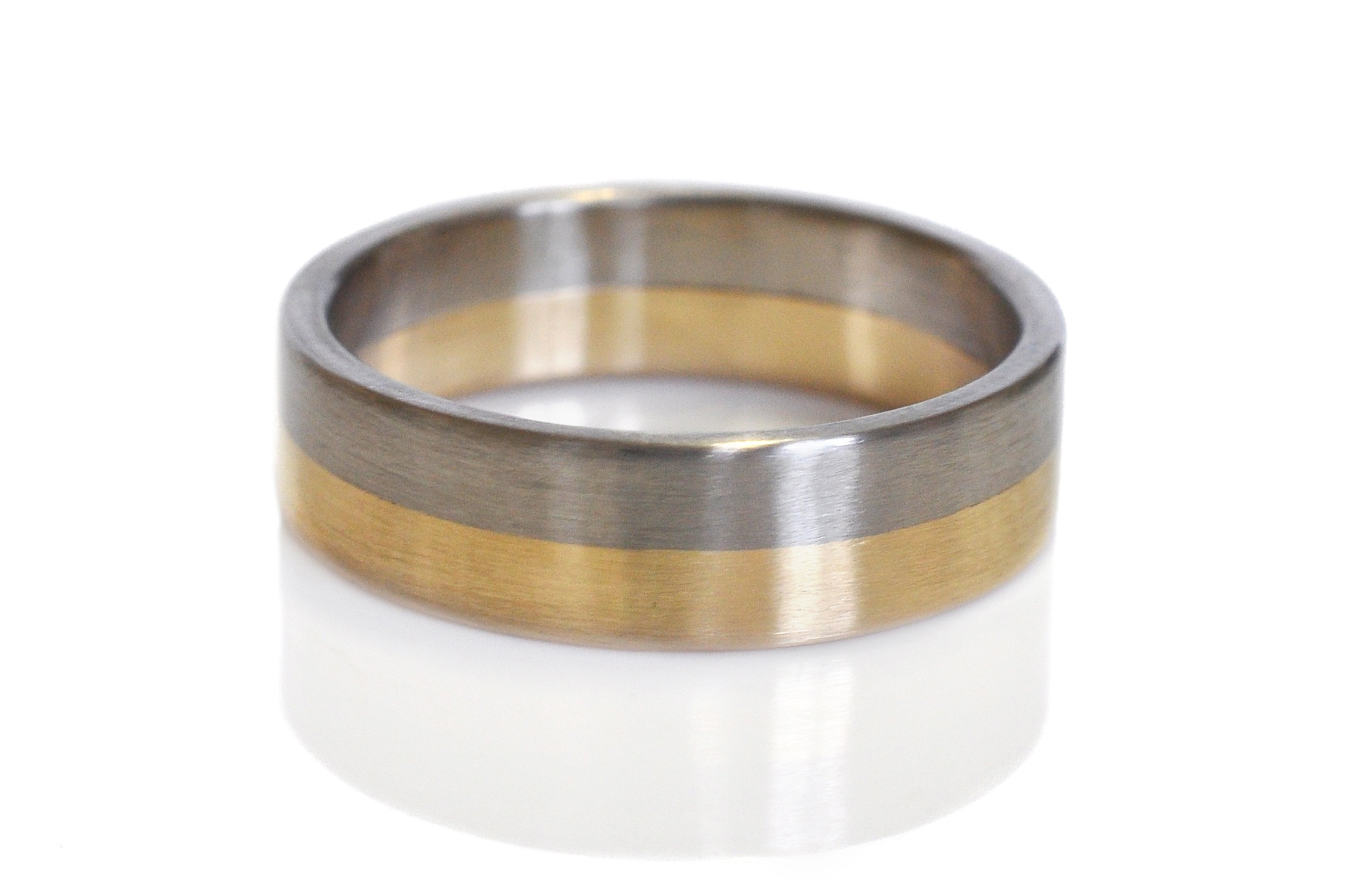 For Andrew, we melted down his grandfathers wedding band to make the gold section of this ring and paired it with 500 palladium for contrast. This is a very special wedding band.