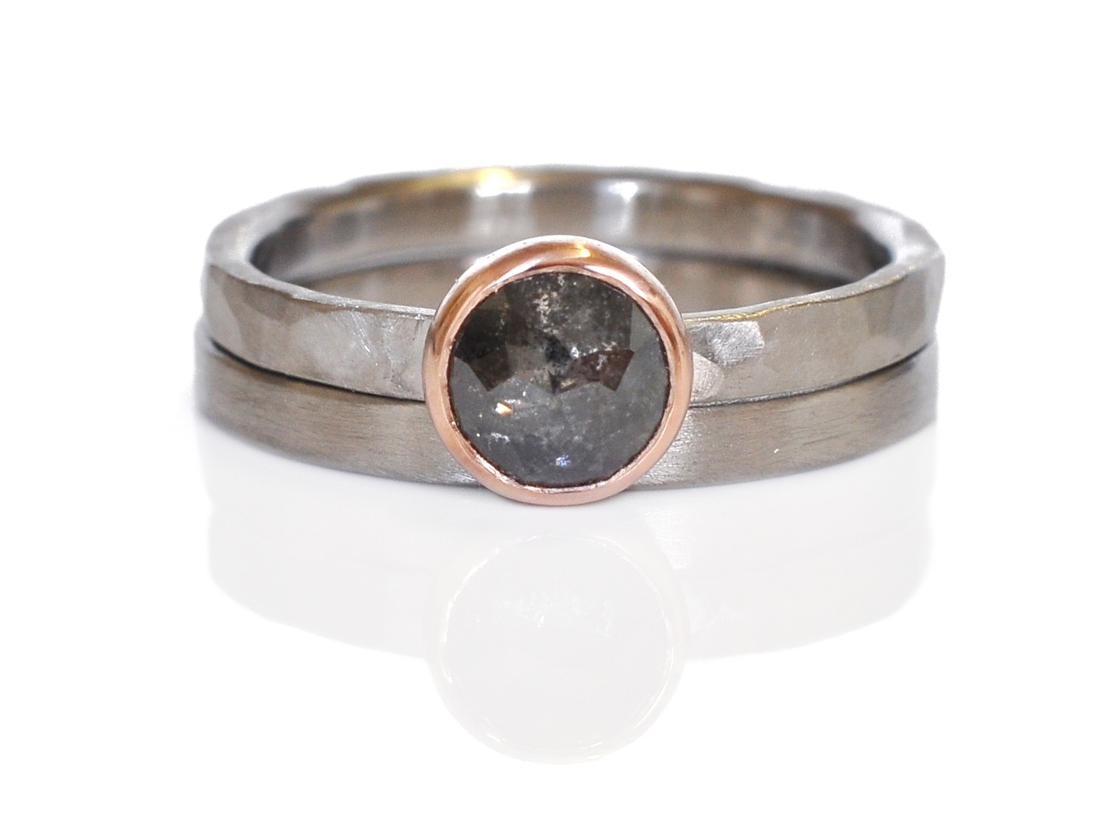 Dark and moody with a pop of pink! Erin picked out a salt and pepper diamond in 14k red gold and paired it with mixed textures of 500 palladium.