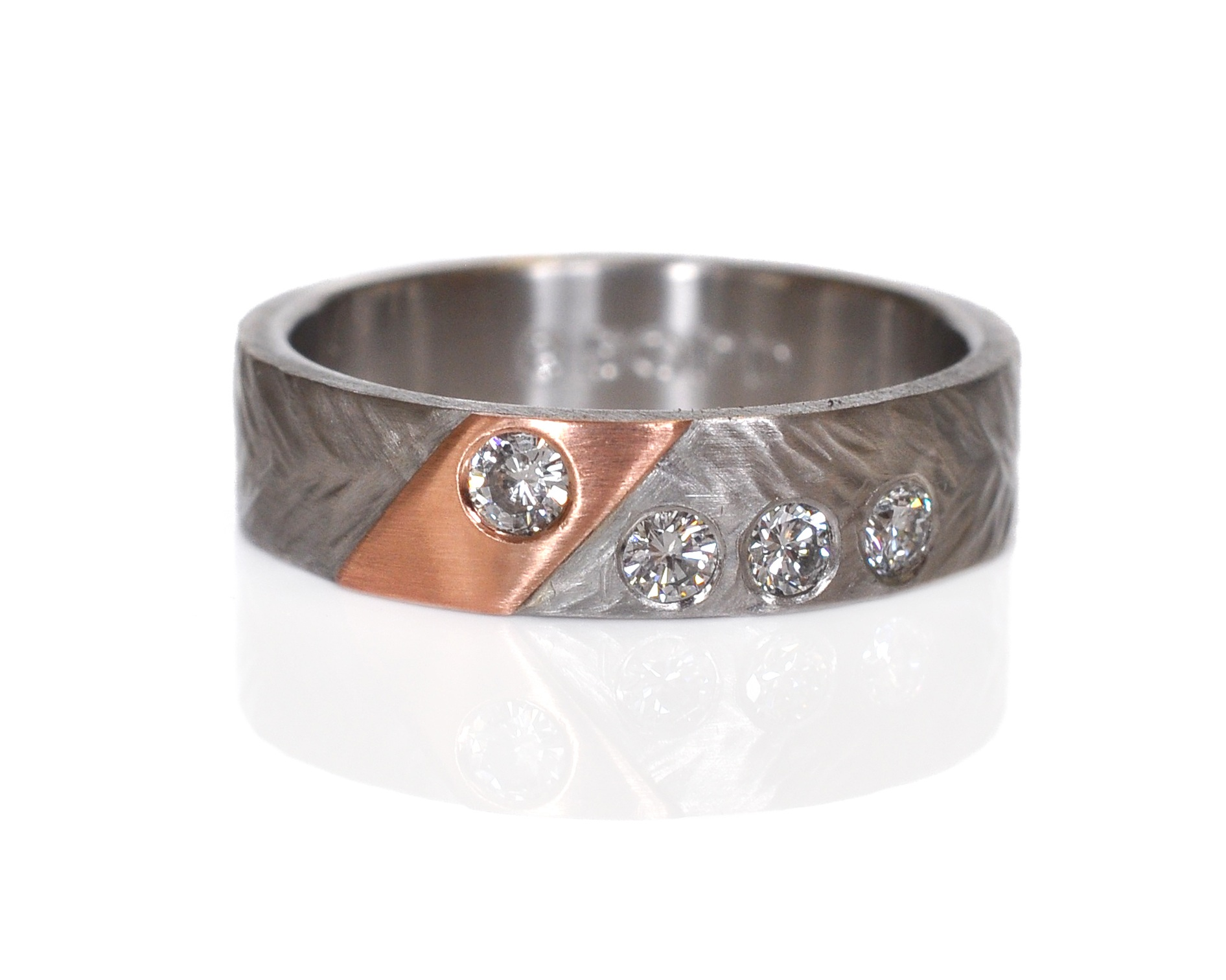 Kelly and Star had family diamonds they wanted to incorporate into Kelly's ring and boy do they sparkle!!!  Wheat hammered palladium with a 14k red gold accent and flush set diamonds.  I love the asymmetry!