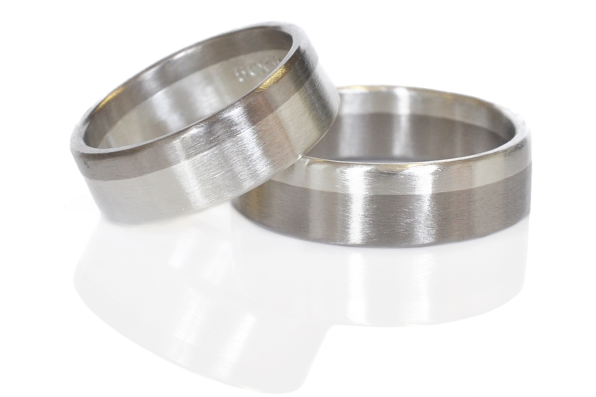Sleek satin finish wedding bands for Her, Him, Them in 500 palladium and sterling silver