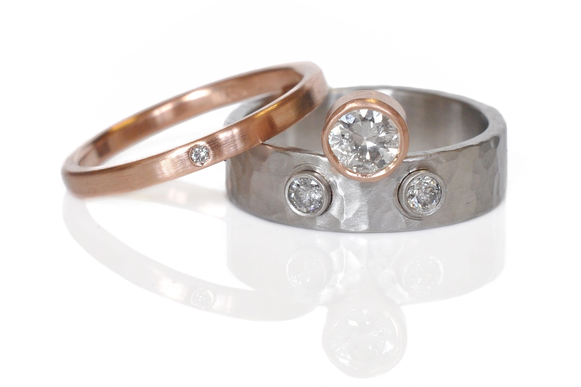 A beautiful and creative remount of family diamonds in a fun stacked set of hammered palladium and 14k red gold.