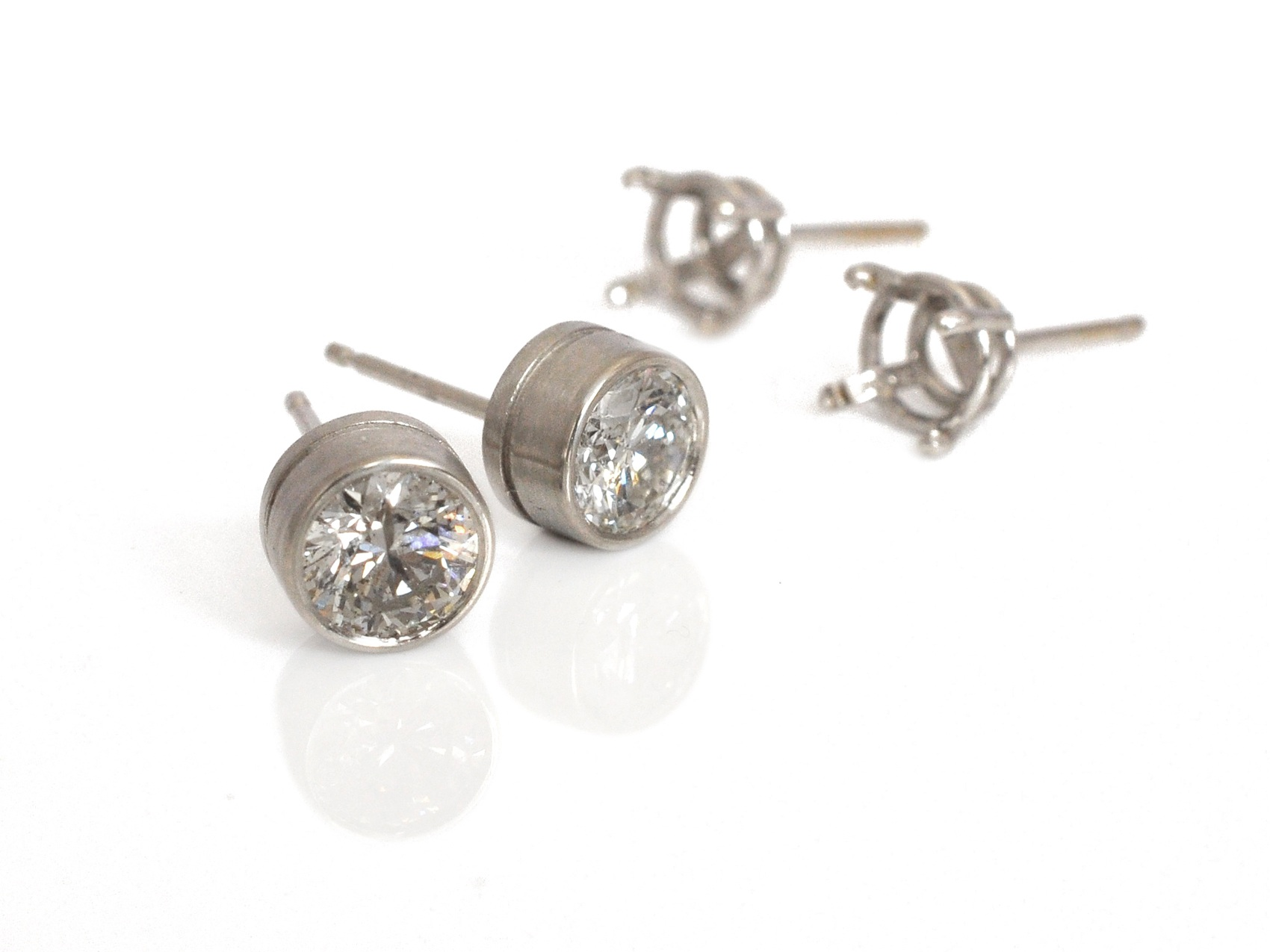 Did you know we can update your earrings too?  We modernized  these classic diamond studs by switching them from prongs to a bezel.