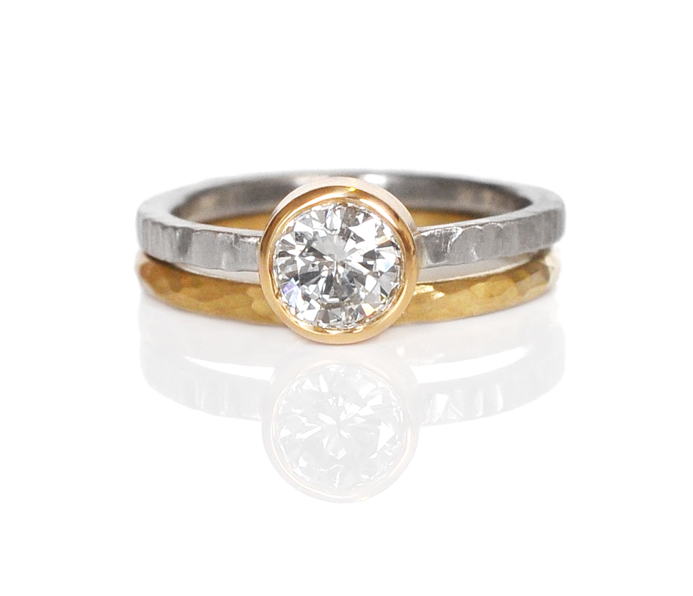 A beautiful mixed texture diamond remount for Jan! An 18k yellow gold bezel for her white diamond, set on a linear hammered palladium band and stacked with a round hammered 18k yellow gold band to bring out the bezel color.