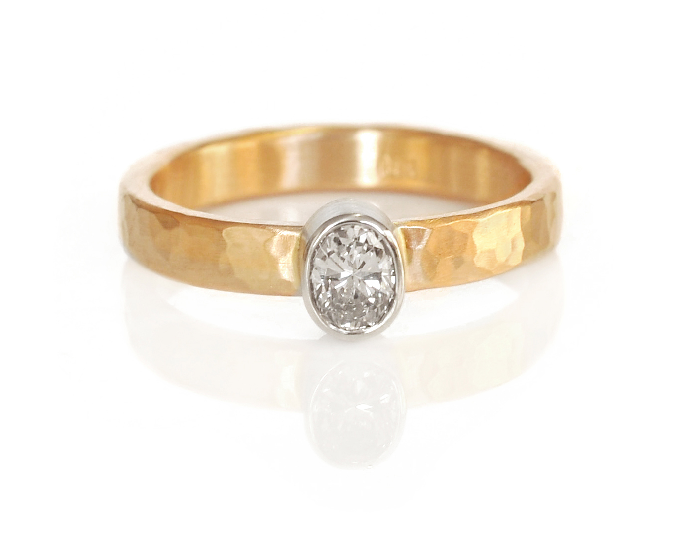 A family diamond re-mounted into a modern setting of 14k white and yellow golds with a hammered texture.