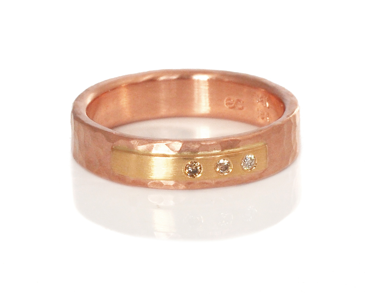 A classic EC Design Rivet Ring in hammered 14k red gold with a 18k yellow gold strip and an ombre of champagne to white diamonds.