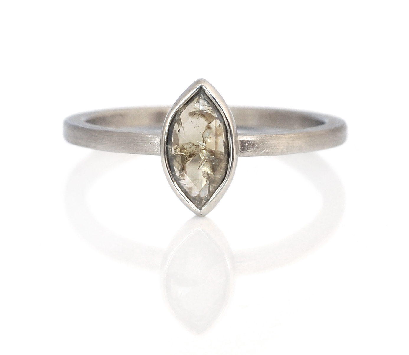 Gray-green rose cut marquis diamond in an open back bezel and band made of 14k gray gold.