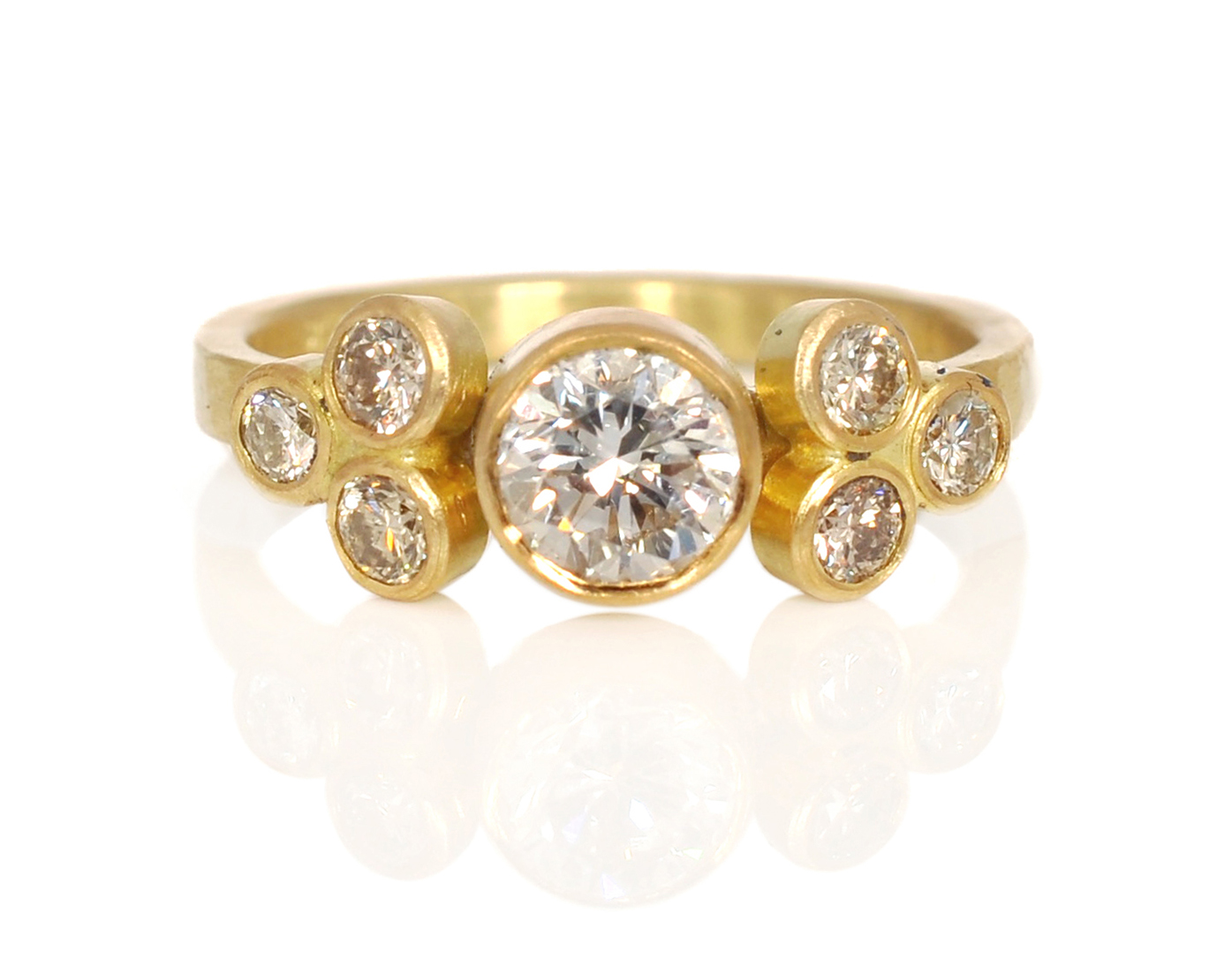 This absolutely stunning ring was created with family diamonds, a few champagne diamonds and 18k gold!