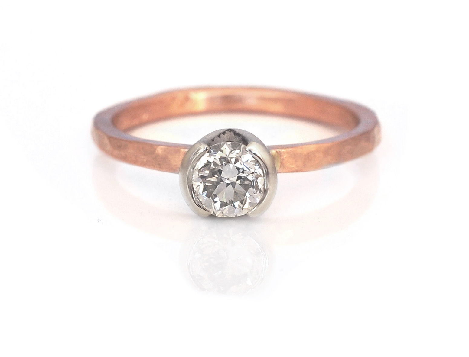 Ashley and Tyler chose a 1/2 bezel setting for their family diamond in 14k white gold and paired it with a hammered 14k red gold band.  Simple and elegant.