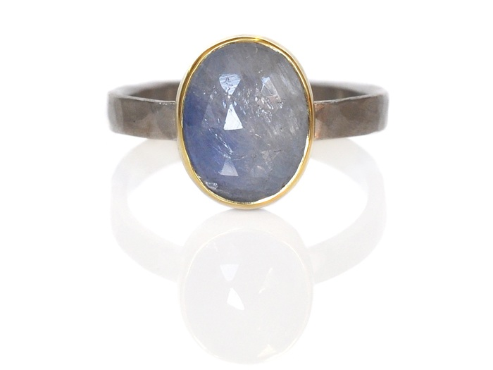 Mary designed this beautiful sapphire ring for herself!  The color variations in the stone are just icy and beautiful!  Blue oval rose cut sapphire in 18k yellow gold on a wide hammered palladium band.
