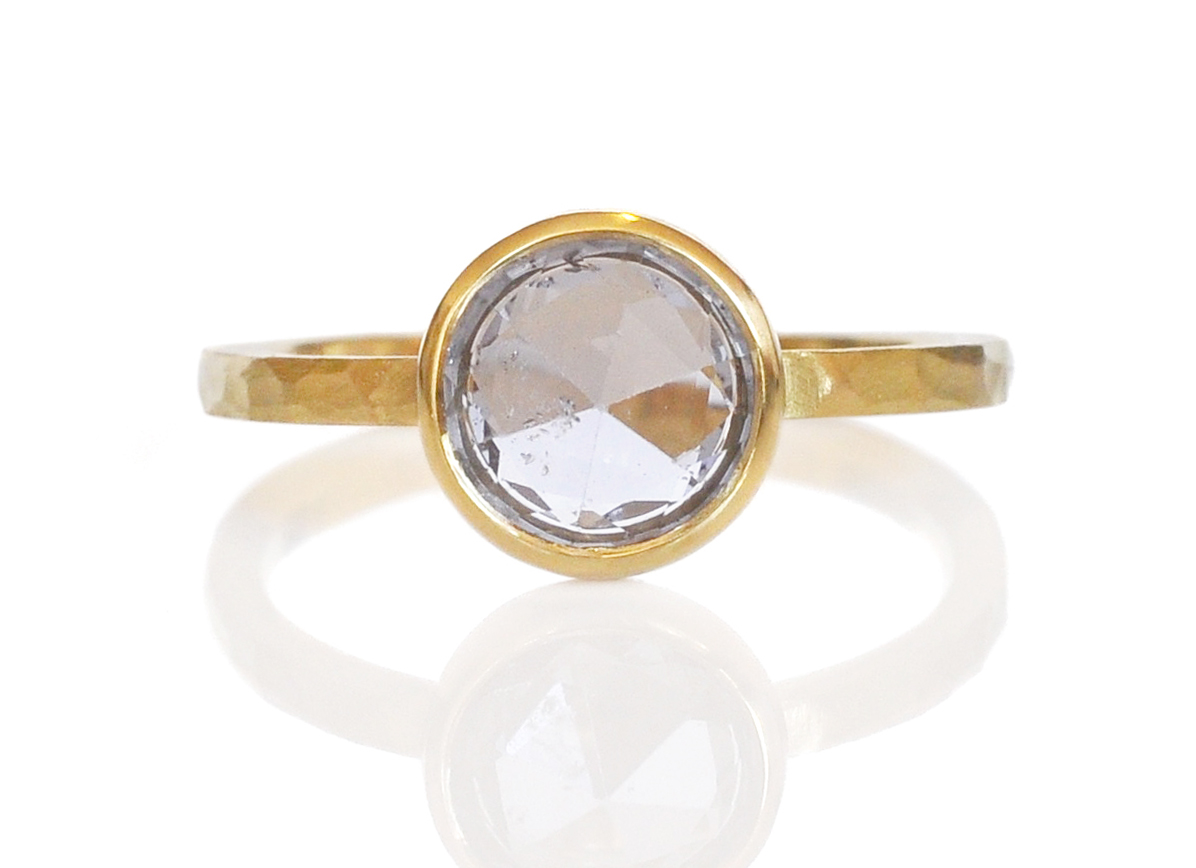 A gorgeous pale lavender rose cut sapphire in hammered 18k yellow gold