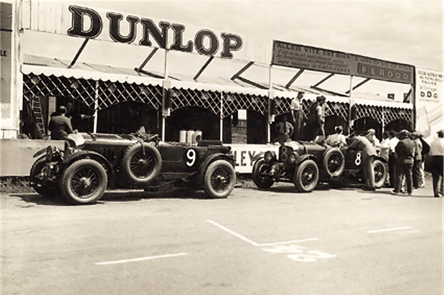 Two 4.5 litre Blowers outside the pits on practice day Le Mans 1930.jpg
