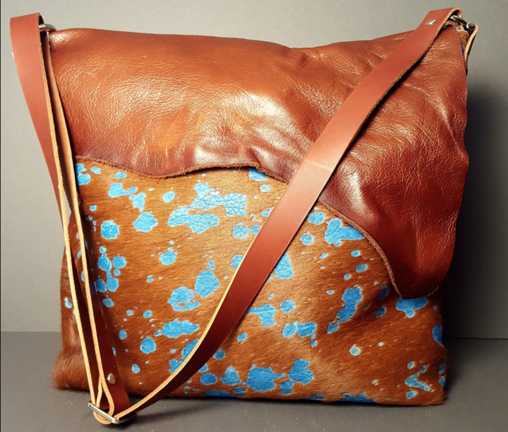 Kerrin Pogozelski - http://www.buxiejobags.comI made leather bags and accessories using uniquely treated leather and cowhide. I love to feature brand marks and scars to create absolute OOAK pieces with a rustic/refined voice.