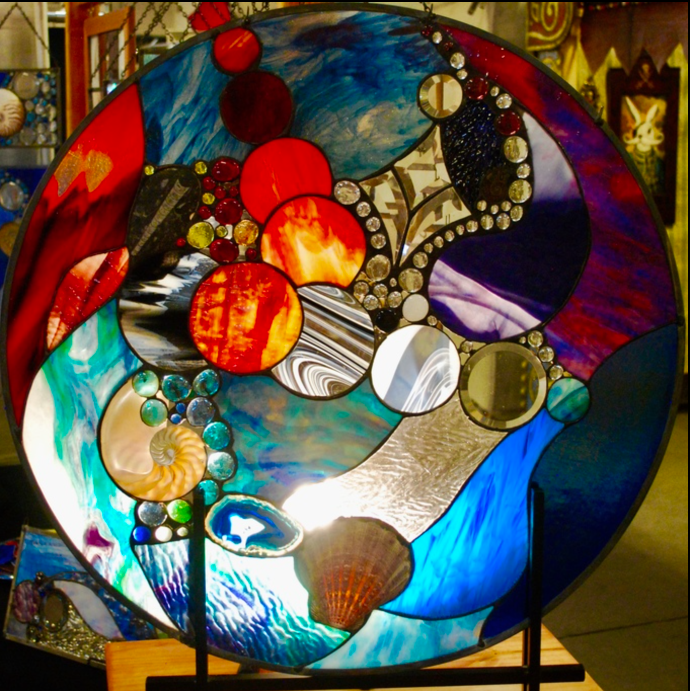 Steve Knox - http://www.daseindesigns.comStained Glass windows ranging in size and shape from 14