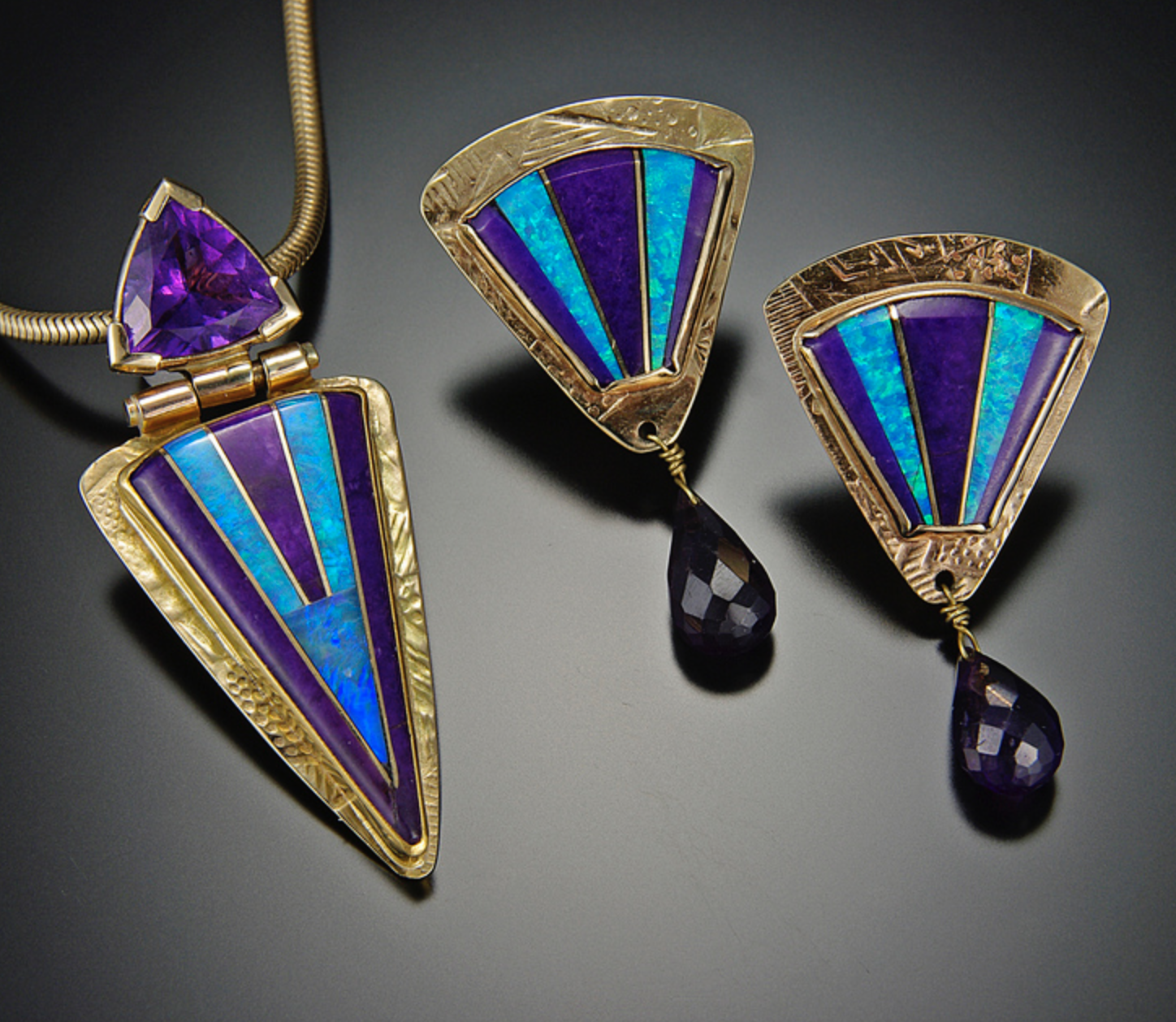 Betsy Bracken - I create colorful inlaid gemstone jewelry in silver & gold,that is either cast from my original waxes,or fabricated from sheet and wires. I also have a line of cuff bracelets in silver, gold & copper.