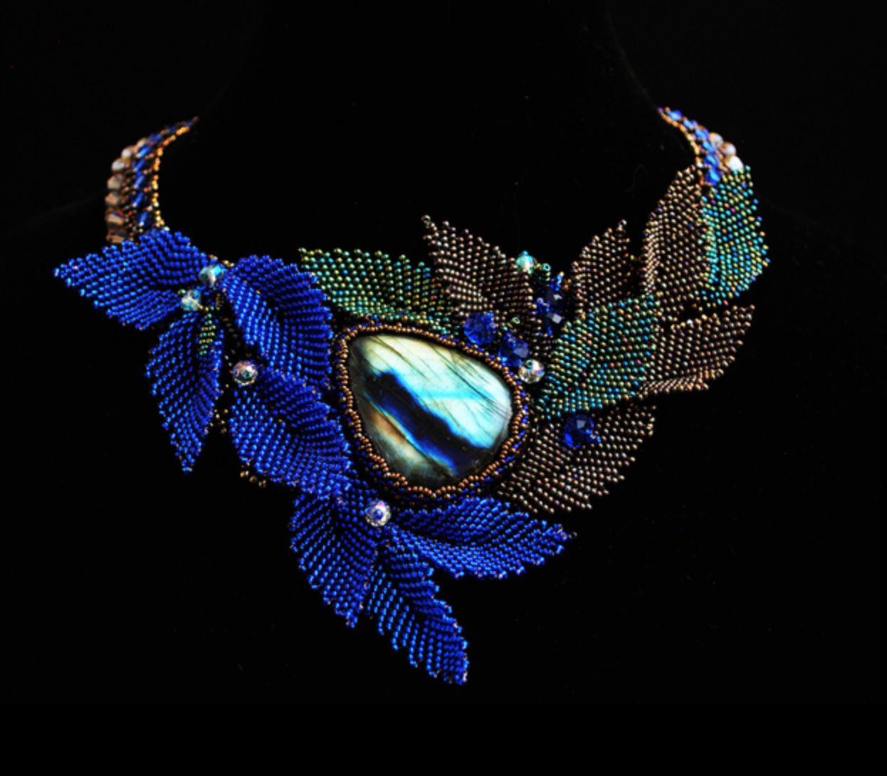 Lisa Davin - http://www.designsbylisajewelry.comI create one of a kind pieces of wearable art jewelry. I seed bead, knot, wire, weave and crochet. I use semiprecious stones, pearls, silver, crystal and seed beads.