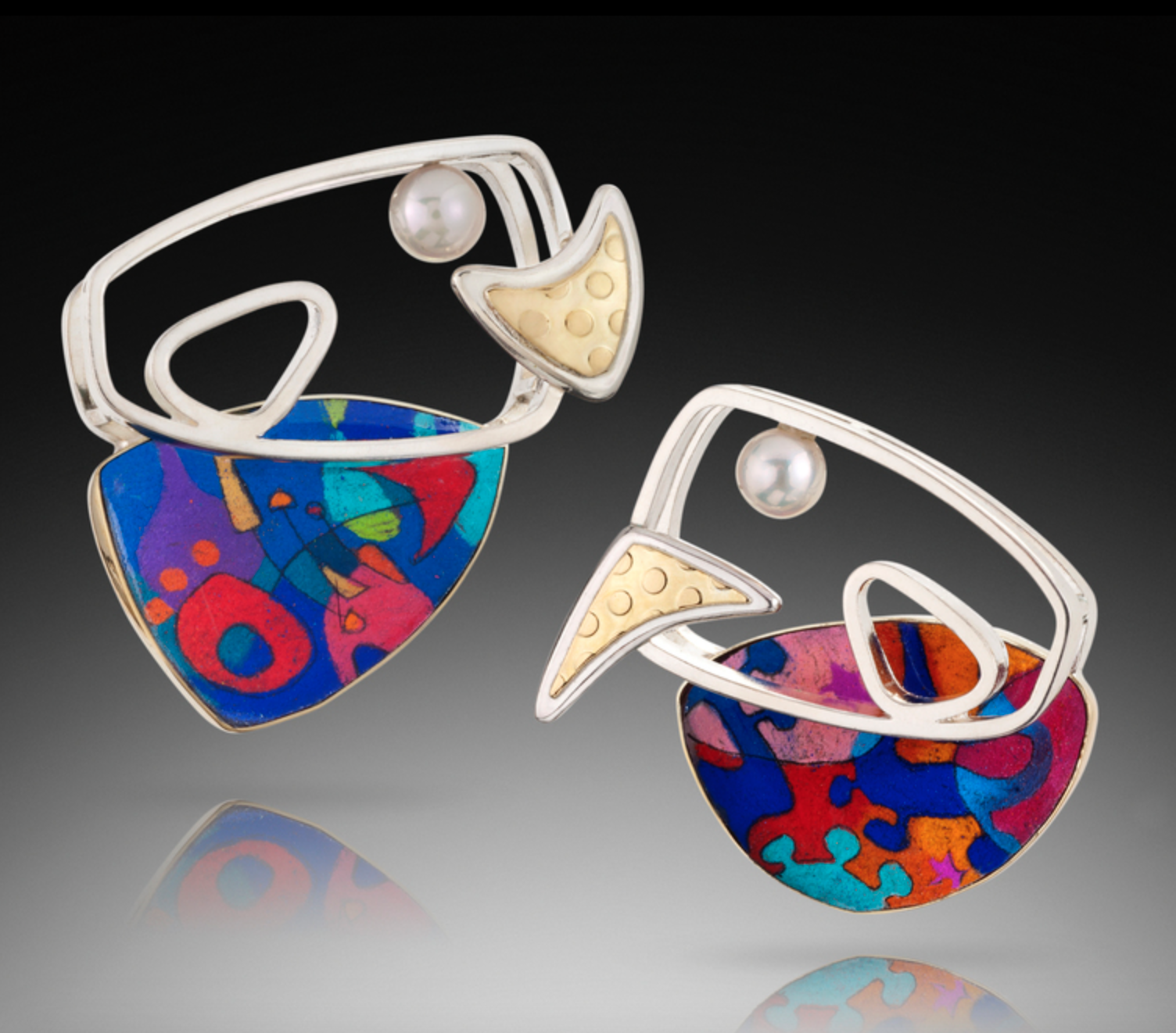 Wendy Newman - http://www.wendynewmanjewelry.comSterling & 18k gold fabricated jewelry w/ colored stones; some handcut. Cabachons made from original prismacolor & ink drawings under enamel. Work features intricate piercing and hand texturing.