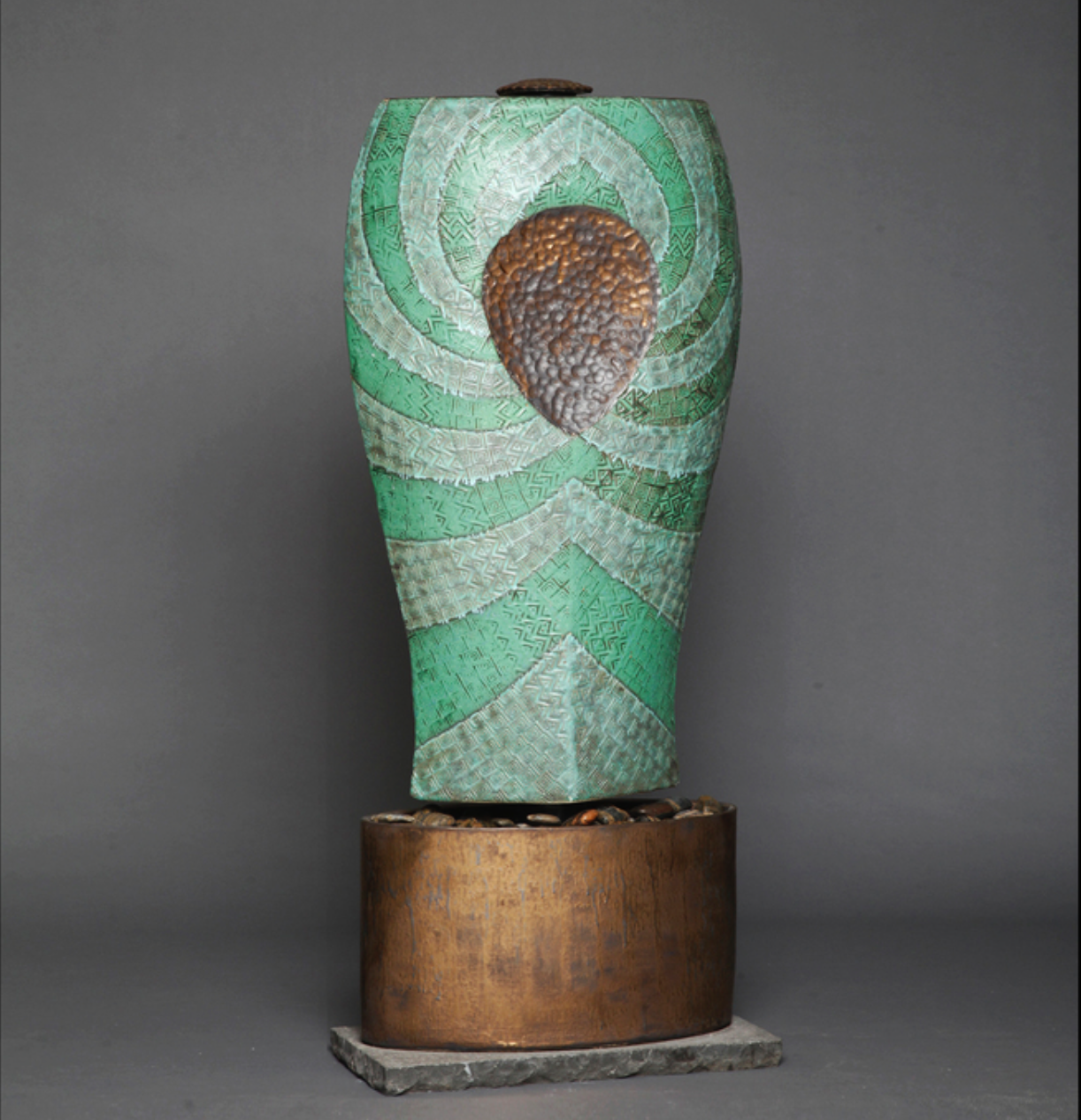 Damien Jones  - http://damienjonesart.comHighfired, handbuilt ceramic sculptures, wall pieces, and water features. Decoratively textured and glazed