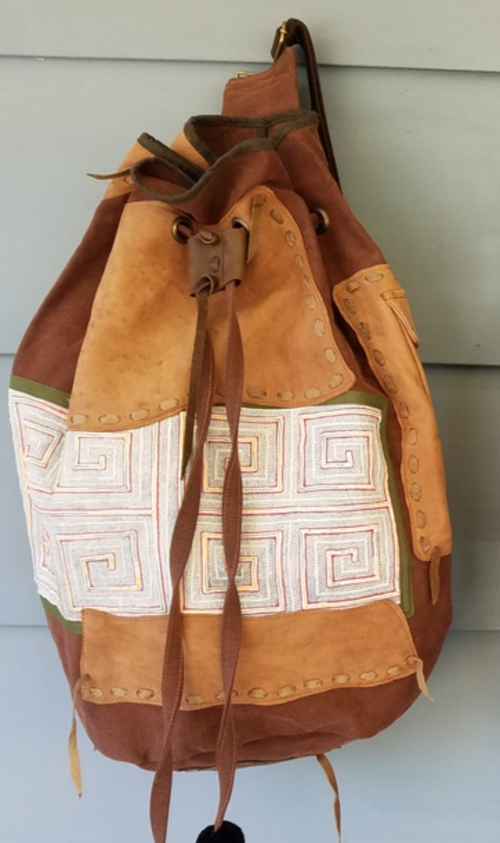 Naweeya Omer - I make purses from re-purposed leather and antique swatches of tribal fabrics; I design and sew summer dresses and animal themed items for children out of fabric.