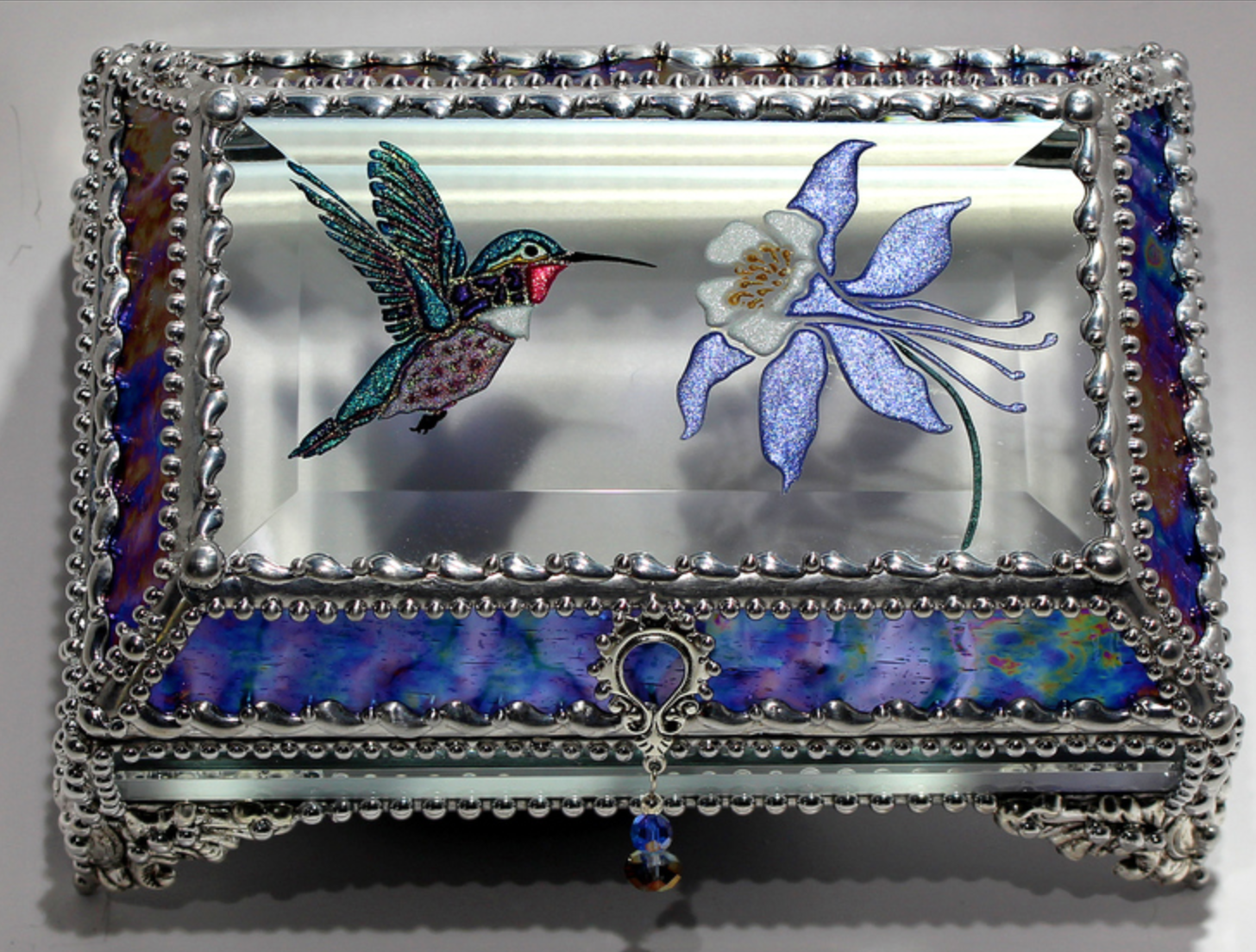 Kimberly Reed - http://glasstreasurebox.comWork combines hand worked metal, hand sandblasting, hand painting, hand cut bevels and glass