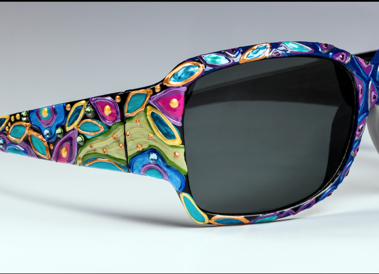 Karin Frye - http://art4theface.comOriginal hand painted eyewear: sunglasses, reading glasses, bi focal sunglasses. All sunglasses are made to the artists spec. Combination of acrylics are used to create geometric and mosaic designs.