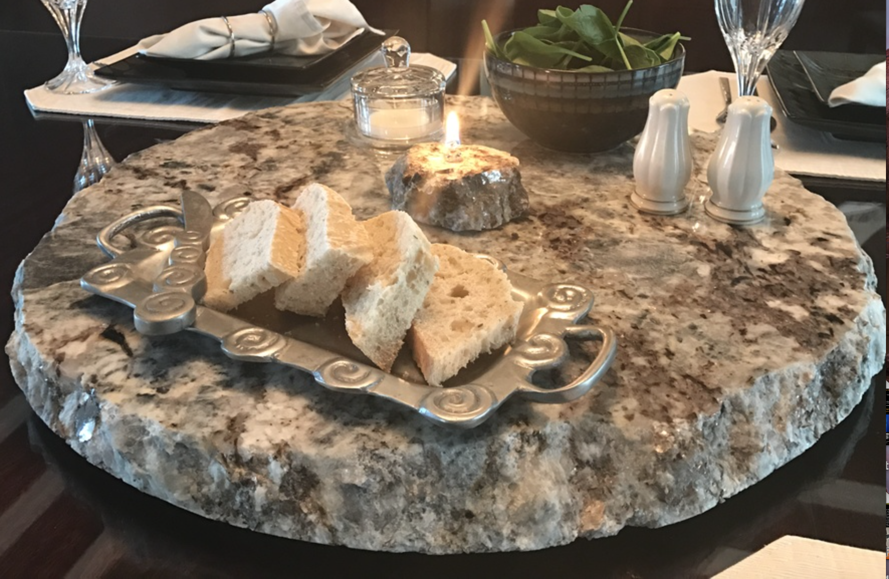 Debi Letner - http://www.rougharoundtheedge.comI hand chisel oil candles, lazy susans, serving stones with oil candles, & wine glasses out of granite, slate, and other natural stones. Each piece is custom made, unique, & will last for generations.