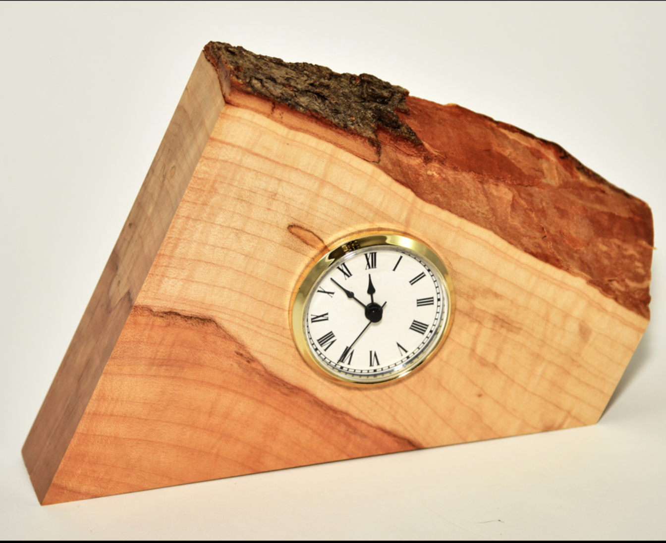 Amber Taylor - I take a variety of hardwoods and mill, laminate and finish them into functional wood art; end-grain cutting boards, lazy susans, bowls, clocks, wall hangers, and desk organizer.