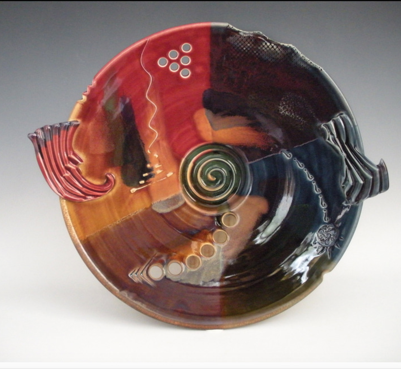 Daniel Marshall - My work is hand-thrown and hand-built porcelain. Each piece is glazed and high-fired in a gas kiln.