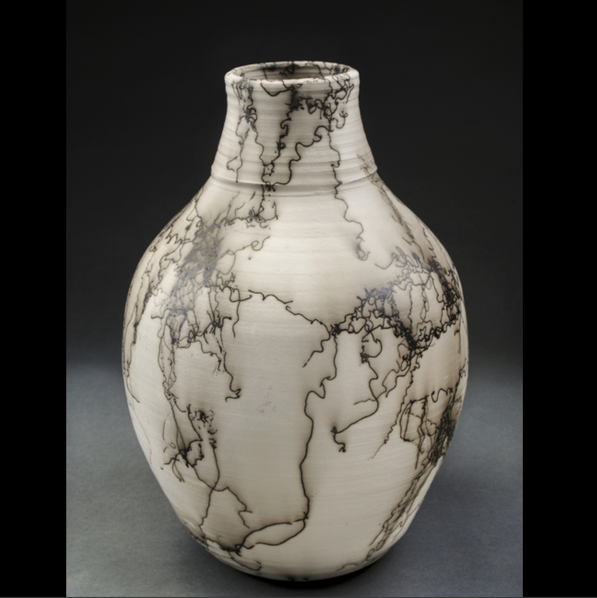 Rebecca Skow - One of a kind art vessels, thrown and altered with firing techniques that include wood firing and horse hair raku.