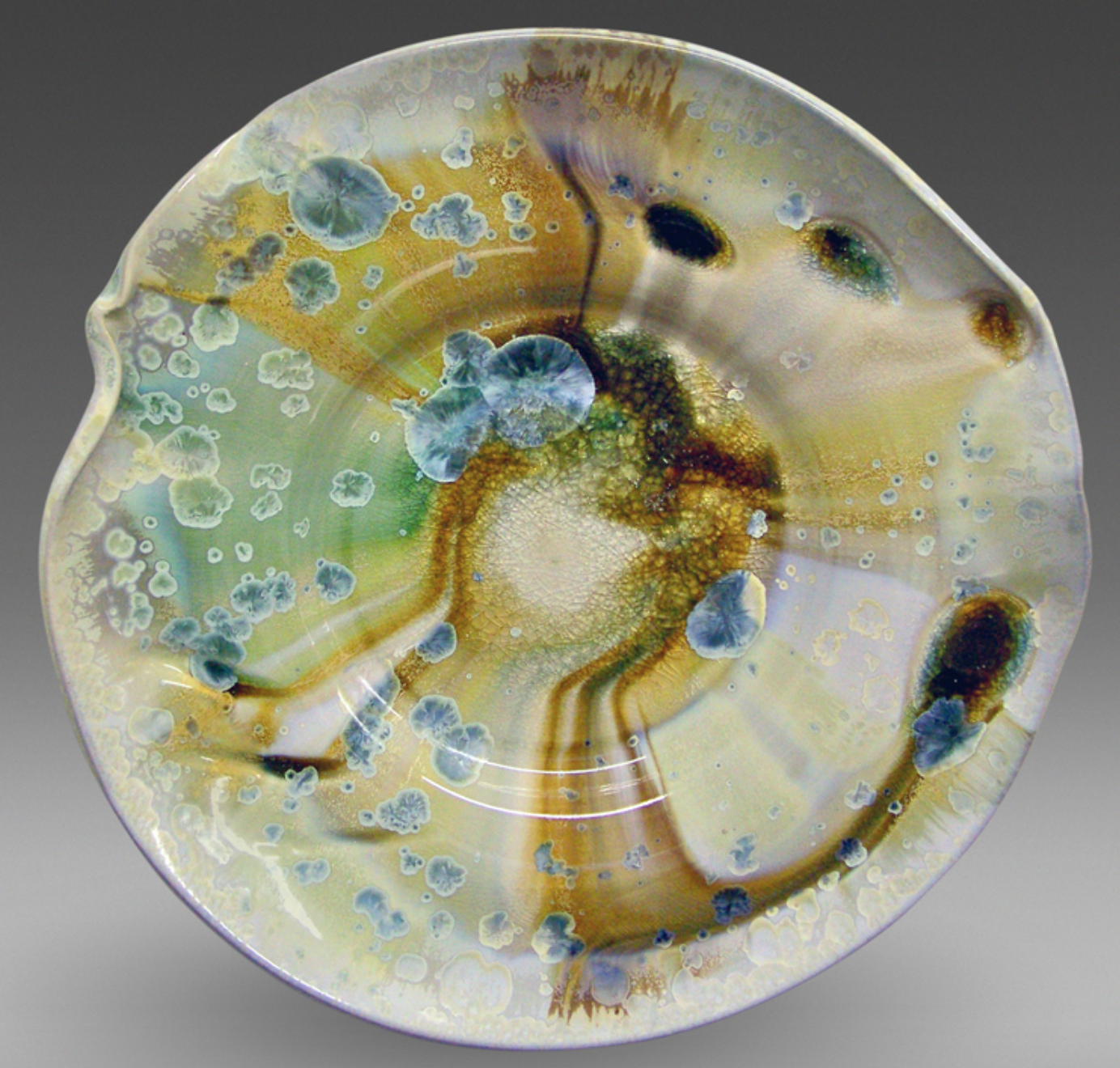 Craig McMillin - http://studiomcmillin.comI individually wheel throw each piece of stoneware clay and manipulate while still damp. After bisque firing, the work is either gas or electric fired to cone 10 with crystalline glazes