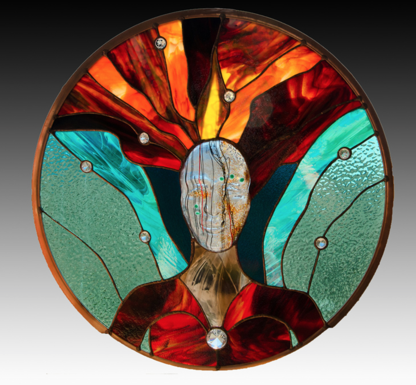 Debb Cusick - http://runningwolfstudio.comStained glass & kiln formed glass, in a contemporary, sculptural or abstract design.