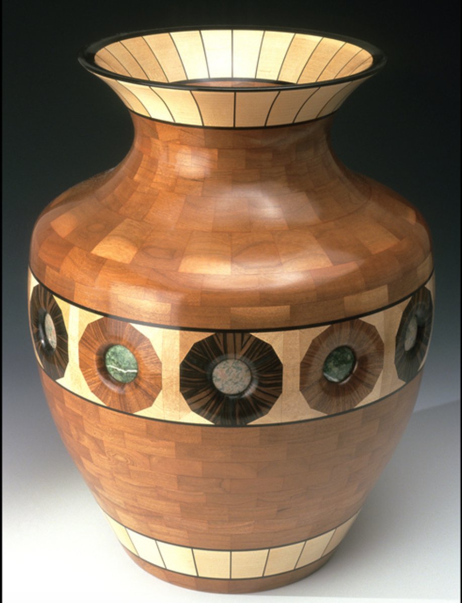 Tim Niewiadomski - http://www.studiobyski.comSegmented wood turnings. Woods are cut into small, precise shapes to create intricate designs for each piece. All natural grains and colors. On occasion I use semi precious stones within my designs.