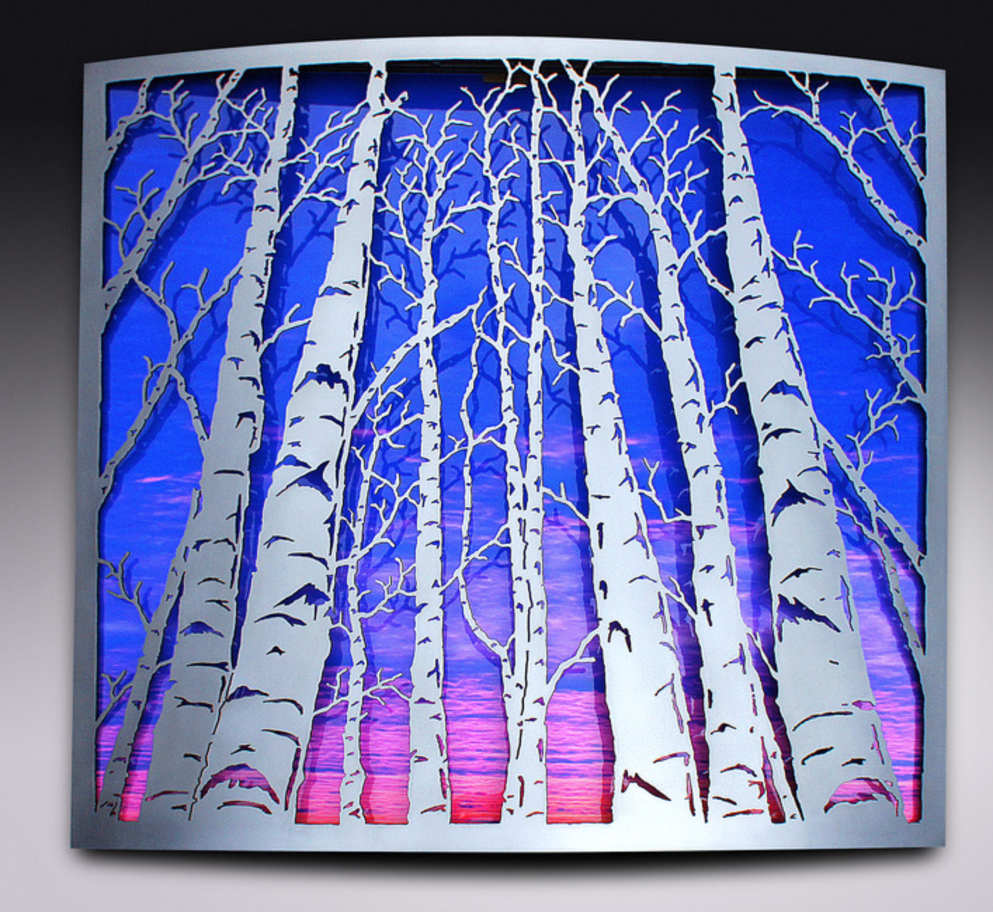 BenJamin Stielow - http://WWW.Bjamincustoms.comWith raw steel & stainless, I use a torch to cut & create the relief which is my work. I focus much on my imagination of trees, taking great pride in my patinas; no paints, pigments, or dyes are used