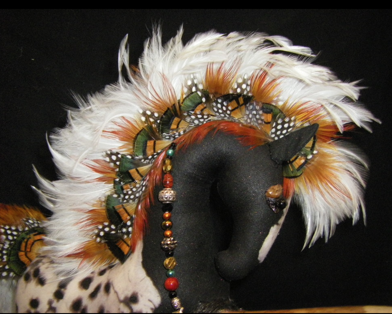 Robyn Hanna - Hand-dyed fabric body.Smooth pine branches as legs.Feathers as manes tails and embellishment.Pine cone petals as hooves,eyes,noses.Adorned with beads,Creating Horses,Moose,Elk,Buffalo,Bighorn,and more