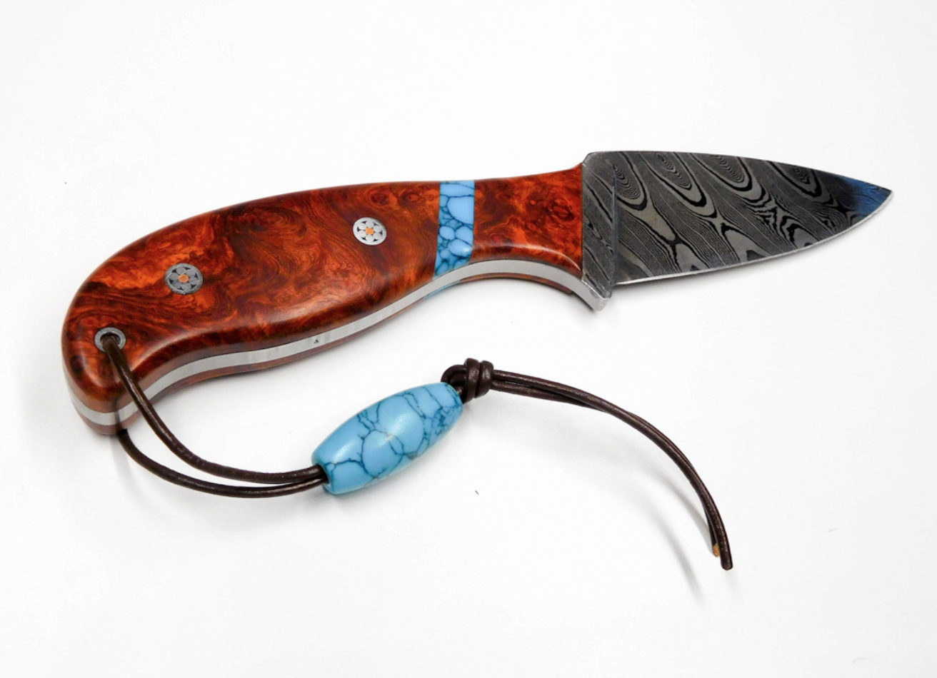 Brent Nilson - http://www.jbeagle.netI design, craft, and install special handle material on knife blades. Wood, Antler, Buffalo Horn, Buffalo Bone, Camel Bone, OtherI specialize in Damascus multi layer steel blades -very artistic