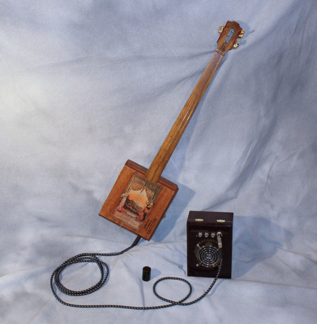 John Vick - I craft playable instruments using cigar boxes, hardwoods and upcycled materials. These vintage looking guitars and banjos have real Americana sound! Add a matching amp and welcome to the blues.