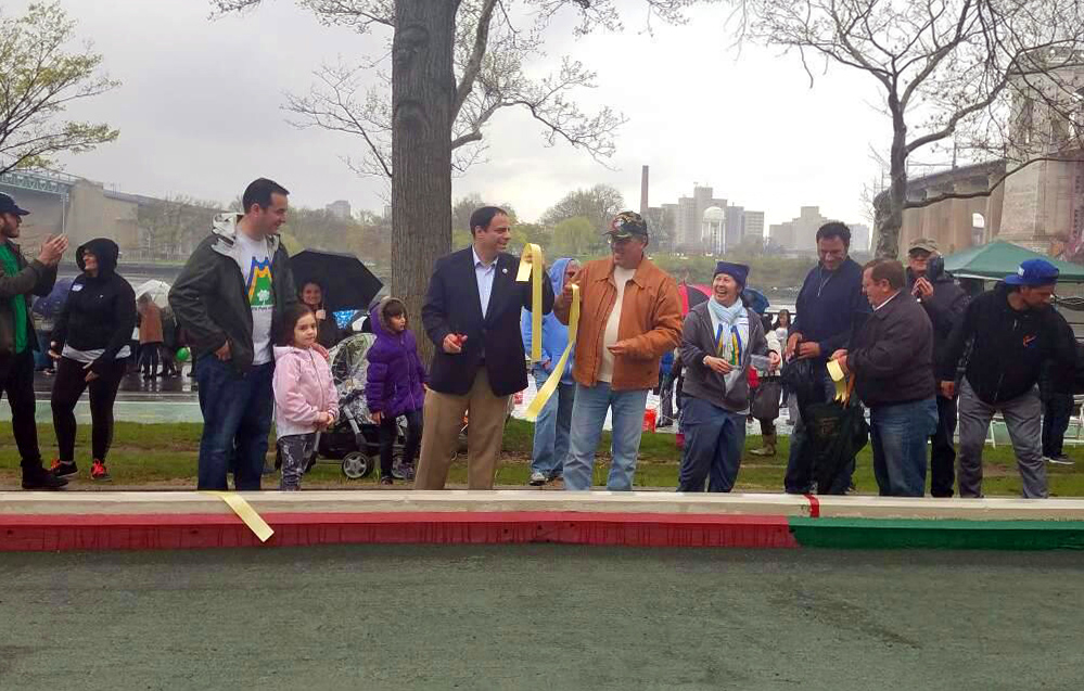 Council Member Costa Constantinides cuts ribbon to officially reopen Bocce Ball Court