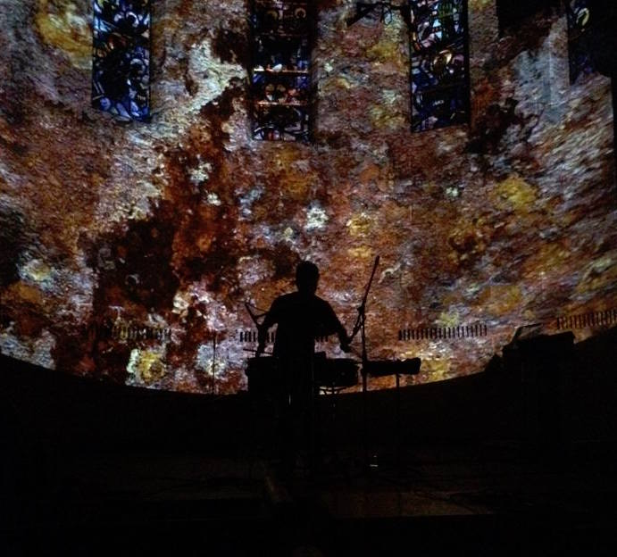 Justin Gunter performing  Rust  silhouetted by live projections at Fairchild Chapel, Oberlin, OH 2014